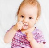 Small girl eating Royalty Free Stock Photography