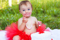 Small girl eating cake Stock Photo