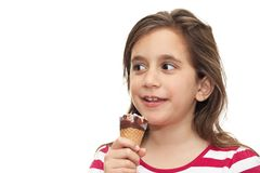 Small girl eating an ice cream cone Royalty Free Stock Photography