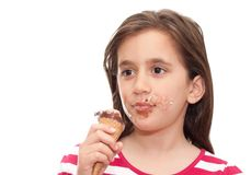 Small girl eating an ice cream cone Stock Images