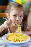 Small girl eating spaghetti Royalty Free Stock Photo