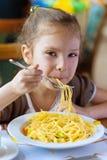 Small girl eating spaghetti Royalty Free Stock Photo