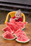 Small girl eating a watermelon Royalty Free Stock Images