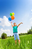Small girl with emotions and colorful balloons Stock Images