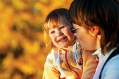Small girl enjoying life with her mother Stock Images