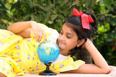 Small girl exploring the globe Royalty Free Stock Photo