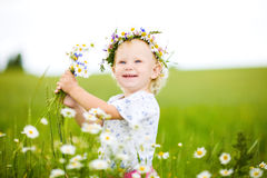 Small girl with field flowers Stock Photo
