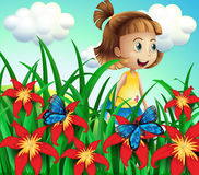 A small girl at the flower garden with butterflies Royalty Free Stock Images