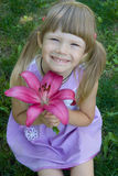 Small Girl and Flower Stock Photography