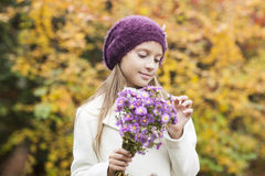Small girl with flowers Stock Images