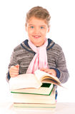 Small Girl in front of a pile of books Royalty Free Stock Image