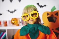Girl wearing pumpkin costume Royalty Free Stock Photo