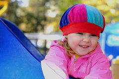 The small girl game of baby park by autumn Royalty Free Stock Image