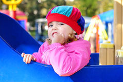 Small girl game of baby park by autumn Stock Photo