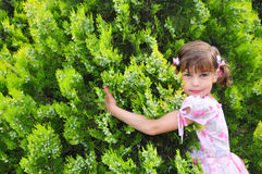 Small girl in a garden Stock Photo