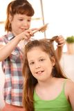 Small girl getting hair comb Stock Image
