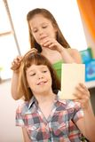 Small girl getting hair comb Royalty Free Stock Photo