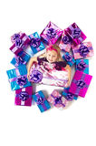 Small girl with gifts Royalty Free Stock Photos