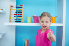 Small girl giving a thumbs up Stock Photos