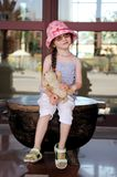 Small girl in glasess and sun hat Royalty Free Stock Image