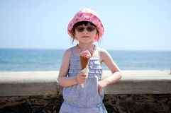 Small girl in glasess and sun hat with ice cream Royalty Free Stock Photography