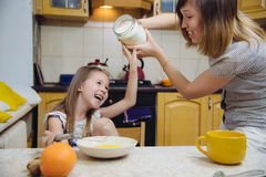 Small girl going to beat the dough for pancakes. Little  mothers helper. Small girl going to beat the dough for pancakes Royalty Free Stock Photos