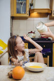 Small girl going to beat the dough for pancakes Royalty Free Stock Image