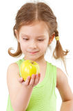 Small girl with green apple Stock Photography