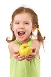 Small girl with green apple Royalty Free Stock Images