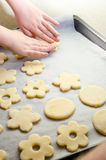 Small girl Hand making Ginger Cookie for christmass. Small child Hand making Ginger Cookie for christmass Royalty Free Stock Photo