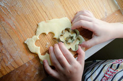 Small girl Hand making Ginger Cookie for christmass Stock Images