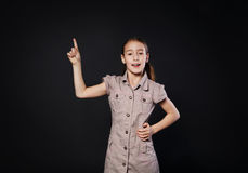 Small girl has idea. Child shows finger up, eureka sign Royalty Free Stock Images