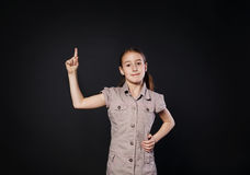 Small girl has idea. Child shows finger up, eureka sign Royalty Free Stock Photos