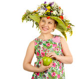 Small girl with hat of flowers Royalty Free Stock Photography