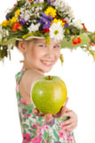 Small girl with hat of flowers Stock Photos