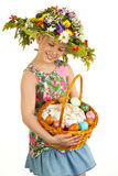 Small girl with hat of flowers Stock Photo