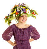 Small girl with hat of flowers Stock Image