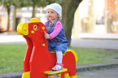 Small girl  having fun. In the park Royalty Free Stock Photo