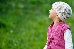 Small girl  having fun. In the park Royalty Free Stock Image