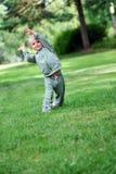 Small girl having fun. At park Royalty Free Stock Image