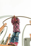 Small girl having fun on the children's attractions Stock Image