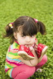 Small girl with her shoes Stock Photo