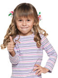 Small girl with her thumb up Royalty Free Stock Photos