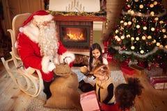 Small girl hold box with Christmas gift Stock Image