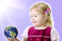 Small girl hold a globe Stock Photography