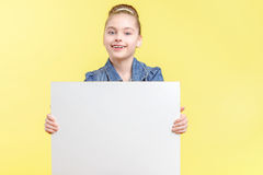 Small girl holding a copy space Royalty Free Stock Images
