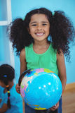 Small girl holding a globe of the world Royalty Free Stock Photo