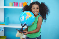 Small girl holding a globe of the world Stock Photography