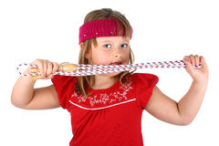 Small girl holding her jump rope isolated on white Stock Image