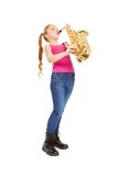 Small girl holding and playing alto saxophone Royalty Free Stock Images